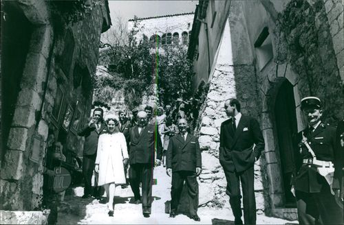 Paul-Henri Spaak with his entourage climbing down the stairs of a narrow passage way.