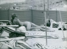 Princess Birgitta relaxing at beach.