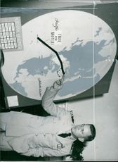 """Commander William R. Andersson shows """"Nautilus"""" course on the map"""