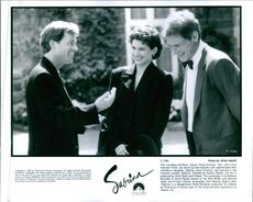 "Greg Kinnear, Julia Ormond and Harrison Ford in a scene from a 1995 romantic comedy-drama film, ""Sabrina."""