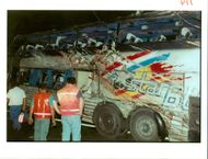 The Beaune coach crash:rescuers stand beside the damaged.