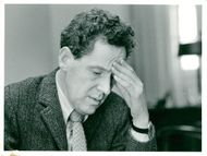 Portrait image of the drama director and author Erland Josephson taken in an unknown context.