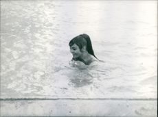 Princess Amina swimming and enjoying the water . 1962.