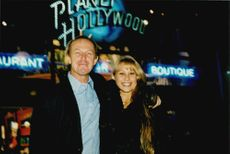 Tennis player Anna Kournikova along with his coach Pavel Slovil outside the Planet Hollywood restaurant