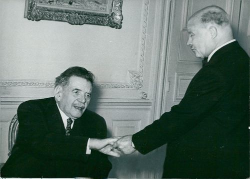 The French National Assembly's President Èdouard Herriot is congratulated by Andre Le Trocquer after being appointed honorary man in his lifetime