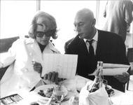 Yul Brynner, smoking with Rita Heyworth.