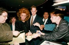 "Sophia Loren writes autographs at a show of her new movie ""Grumpier Old Men"" in Los Angeles"