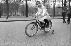 Brigitte Bardot son riding bicycle.