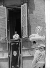 Pope Paul VI standing by the window.