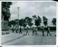 Vietnamese troops file out to the fighting line outside Hanoi.