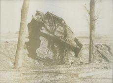 A ruined military tank in the muddy field in France during World War I, 1936.