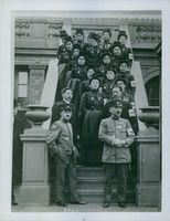 Asian soldiers gathered in the building during WWII.