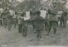 Soldiers playing a music in street in Poland during WWI, 1915.