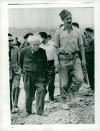 Israel's Prime Minister David Ben-Gurion appears around the field of investigation by Archeologist Professor Yigael Yadin