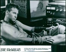 """Val Kilmer stars as Dr. Moreau assistant, Montgomery, in New Line Cinema's sci-fi thriller, """"The Island of Dr. Moreau"""", 1996."""