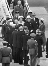 Georges Jean Raymond Pompidou in airport with officials.