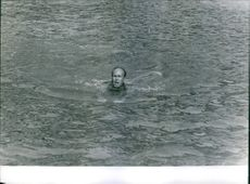 Valéry Giscard d'Estaing is swimming.   Year: 1963