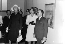 Georges Jean Raymond Pompidou in a painting exhibition with other people.