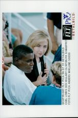 Carl Lewis and Hillary Clinton among the spectators at the sim jump during the Olympic Games in Atlanta in 1996
