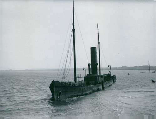 An old ship in water.