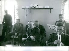 Soldiers sitting together and having communication.