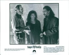 Director Wes Craven (left) discusses a scene with Angela Bassett and Eddie Murphy in Vampire in Brooklyn, a Paramount Pictures Film.