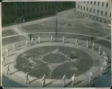 Men walking and making circle.