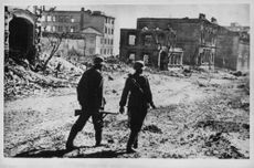 Soldiers walking in the devastated city of Stalingrad, Russia. 1963.