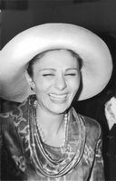 Farah Pahlavi laughing.
