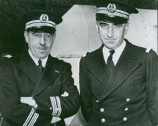 Capt. C.Y.F.M. Perzo (left) and Capt. L.M.P.A. Sala at a U.S. East Coast port to which they brought their ships from Dakar, North Africa.