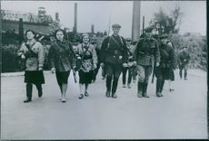 Leningrad, Russia  Men and women in military uniform walking and smiling, 1943.