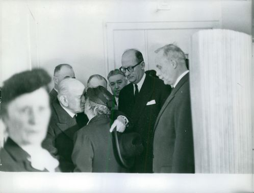 Édouard Herriot kissing a woman, other people standing around looking at them.