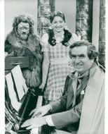 Denis Healey at the piano and Richard Stilgoe and Sue Lawley in