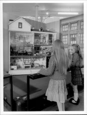 Two visitors admire the exhibition in East End, London. Bethnal Green Museum has all the world's favorite toys.