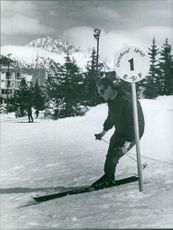 Victor Emmanuel skiing on snow.