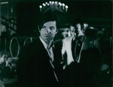 Robert Drivas and David Janssen looking at the same direction during a film shoot.