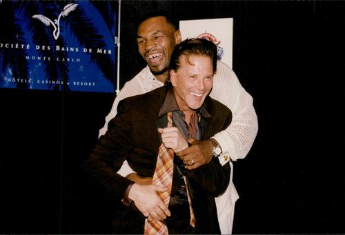 Mickey Rourke hugs with Mike Tyson during World Music Awards.