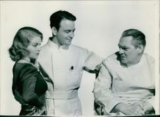 Lew Ayres with unknown man and woman.