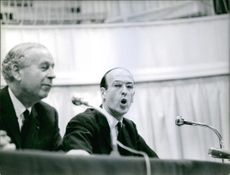 Valéry Giscard d'Estaing is delivering his speech  in a conference. 1965