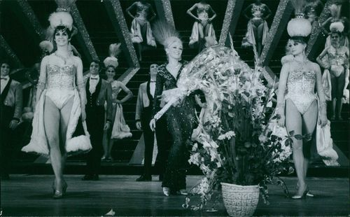 Zazie Varnel, performing on the stage, holding flowers. 1969.