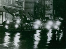 Military tanks in street at night. 1964