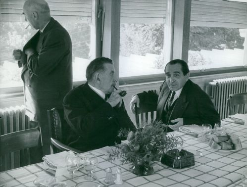 Pierre Mendes France talking to man.