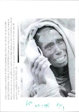 A woman clutching her ration card.