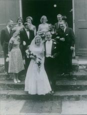Nelson Aldrich Rockefeller standing with wife, laughing together with other couples.