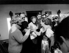 Princess Beatrix with her husband Prince Claus and other people cheering their glass. 1966