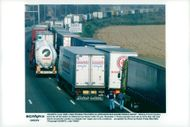 French truck drivers block toll