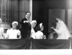 Princess Margaret waving at the crowd with her husband, just after getting married.