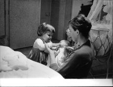 Leslie Caron with her young children.