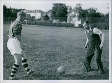 Two footballer playing football.