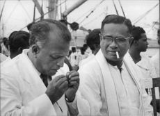 N.M. Perera (left) and Charles Percival de Silva smoking.